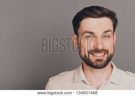 Handsome Happy Smiling Man Isolated On Gray Background