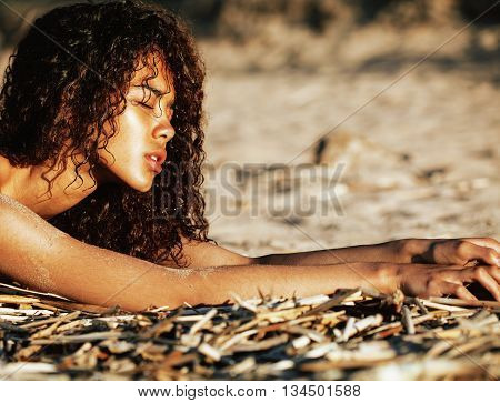 young pretty girl asian face curly hairstyle at beach, vacation tann