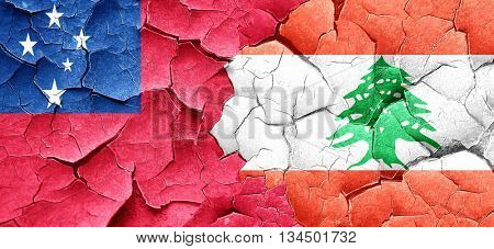 Samoa flag with Lebanon flag on a grunge cracked wall