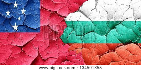 Samoa flag with Bulgaria flag on a grunge cracked wall