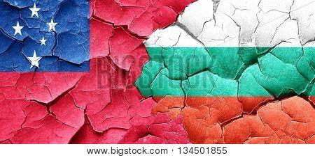 Samoa flag with Bulgaria flag on a grunge cracked wall