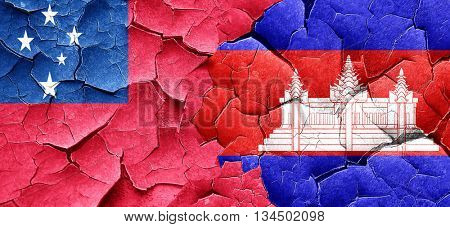 Samoa flag with Cambodia flag on a grunge cracked wall