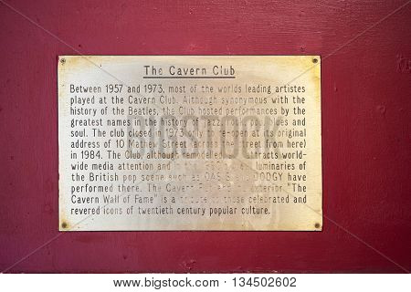 LIVERPOOL, UK. JUNE 09, 2016: Plaque at entrance to The Cavern Club, on Mathew Street, where The Beatles played their first concert, telling the story of the venue.