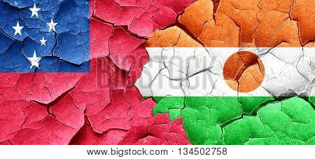 Samoa flag with Niger flag on a grunge cracked wall