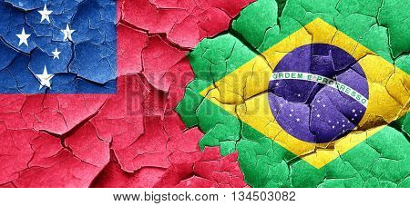 Samoa flag with Brazil flag on a grunge cracked wall