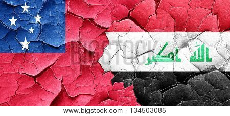 Samoa flag with Iraq flag on a grunge cracked wall