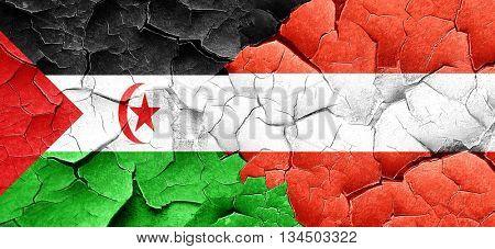 Western sahara flag with Austria flag on a grunge cracked wall