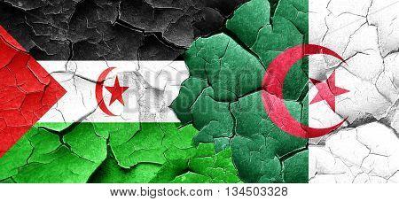 Western sahara flag with Algeria flag on a grunge cracked wall