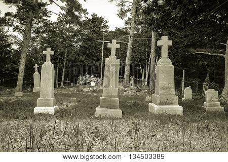 Fayette, Michigan, USA - June 13, 2016: St. Peter The Fisherman Cemetery in the ghost town of Fayette State Park in Michigan's Upper Peninsula.