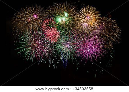 Beautiful celebration golden red purple green sparkling fireworks. Independence Day 4th of July holidays salute. New Year beautiful fireworks. Holidays symbol background.