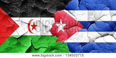 Western sahara flag with cuba flag on a grunge cracked wall