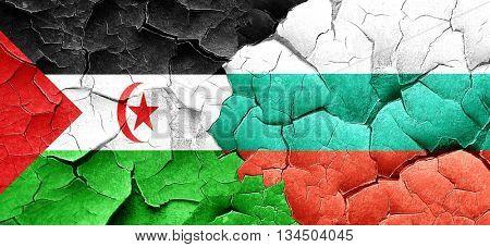 Western sahara flag with Bulgaria flag on a grunge cracked wall