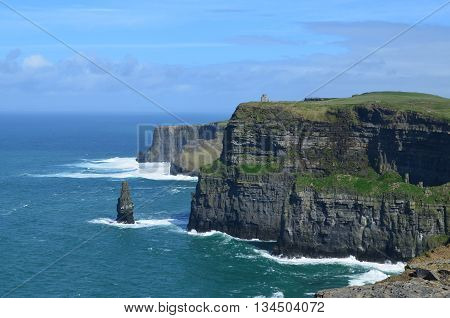 Gorgeous Cliffs of Moher with a sea stack in County Clare of Ireland.