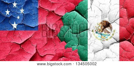 Samoa flag with Mexico flag on a grunge cracked wall