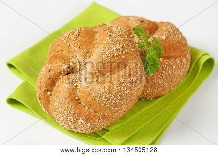 close up of two fresh buns on green place mat