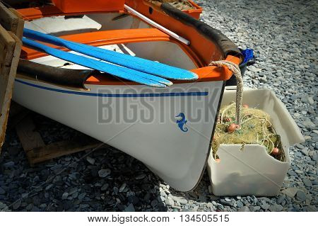 element of old boat with oars on the sea shore