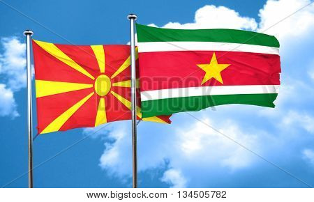 Macedonia flag with Suriname flag, 3D rendering