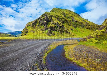 Picturesque basalt hills covered with green grass and moss-polar. At the bottom of the canyon flowing streams lot. Canyon Pakgil in Iceland