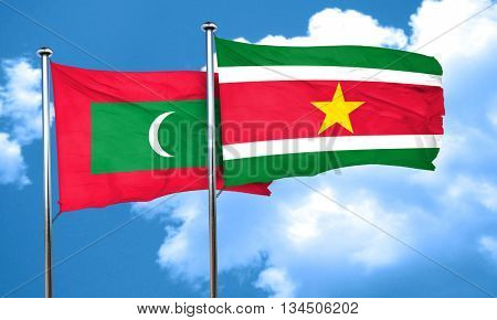 Maldives flag with Suriname flag, 3D rendering