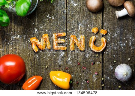 Dough Letters And Vegetables On Rustic Wooden Table, German Word, Menu