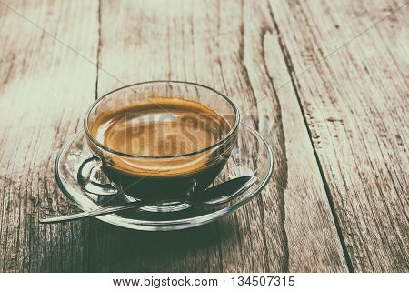 cup of coffee on the table in the morningselective focus