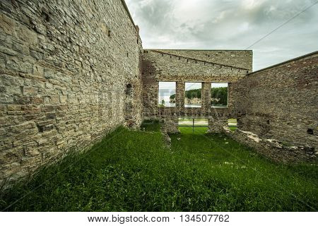 Ruins Of Fayette Ghost Town. Interior of an abandoned building with open windows facing the limestone cliffs on Lake Michigan. Fayette State Historical Park.