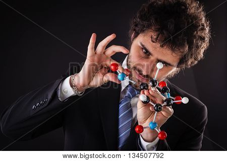 Businessman Building Tnt Molecular Structure