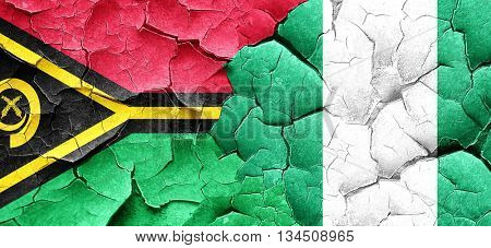 Vanatu flag with Nigeria flag on a grunge cracked wall