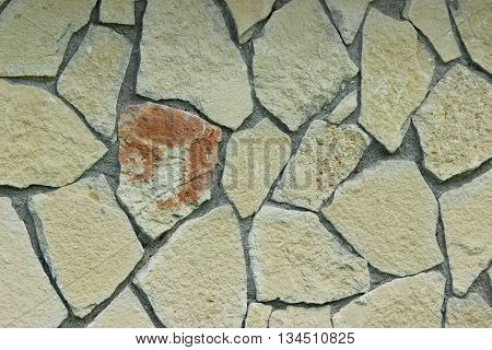 wall of light colored stone. texture background