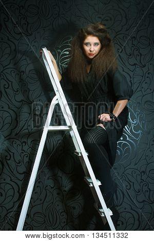 fashion model on the ladder