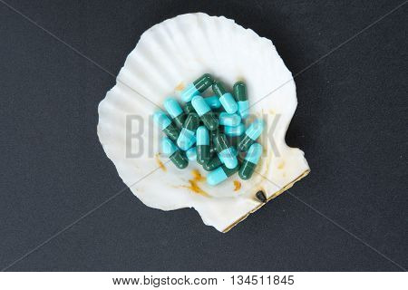 Close up of blue and green capsules medicine antibiotic