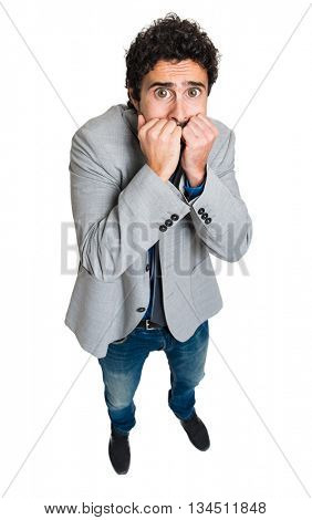 Scared businessman with big wide open eyes