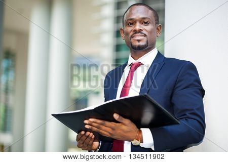 African businessman outdoor holding his agenda
