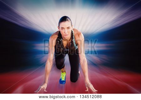 Composite image of sporty woman in the starting block against a design background