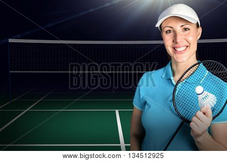 Composite image of badminton player holding badminton racket and shuttlecock against badminton field