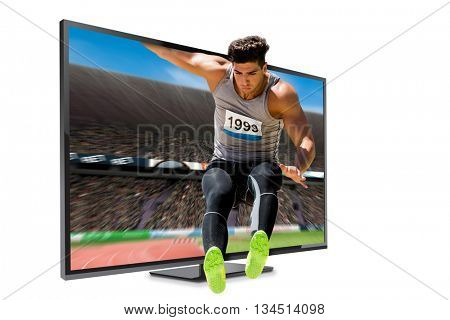 Sportsman jumping on a white background against view of a stadium
