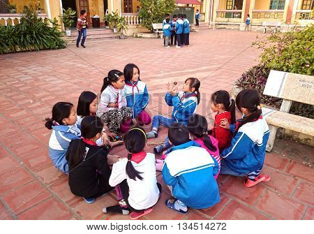 HAI DUONG, Vietnam, May 26, 2016 primary school students, rural Hai Duong, outdoor revise