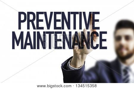 Business man pointing the text: Preventive Maintenance