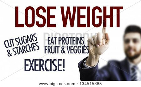 Business man pointing the text: Lose Weight