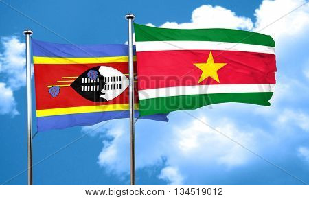 Swaziland flag with Suriname flag, 3D rendering