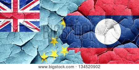 Tuvalu flag with Laos flag on a grunge cracked wall