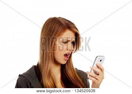 Teenage woman screaming to the phone