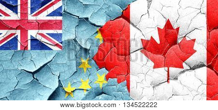 Tuvalu flag with Canada flag on a grunge cracked wall