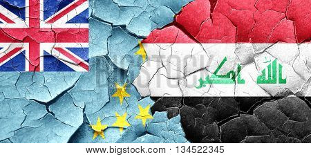 Tuvalu flag with Iraq flag on a grunge cracked wall