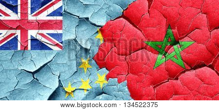Tuvalu flag with Morocco flag on a grunge cracked wall