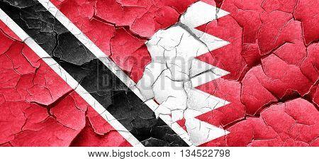 Trinidad and tobago flag with Bahrain flag on a grunge cracked w
