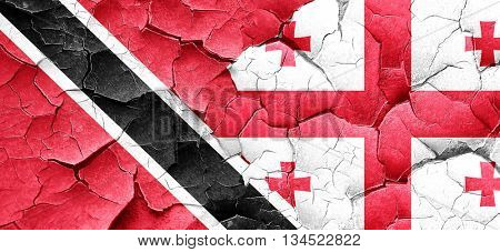 Trinidad and tobago flag with Georgia flag on a grunge cracked w