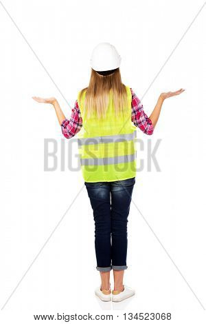 Back view of female builder making do not know sign