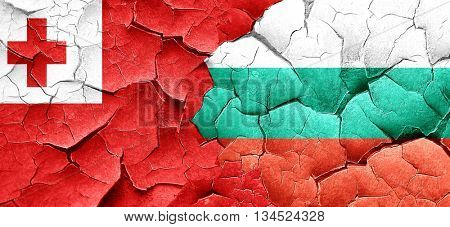 Tonga flag with Bulgaria flag on a grunge cracked wall