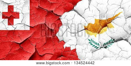 Tonga flag with Cyprus flag on a grunge cracked wall